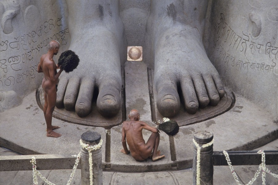 Jain Digambara monks at the feet of Bahubali statue, Shravanabelagola, Karnataka, India