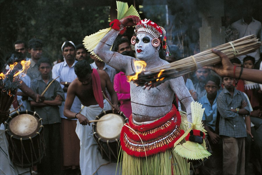 Dance of Teyyam Gulikan, Pallipram kavu, Kerala, India