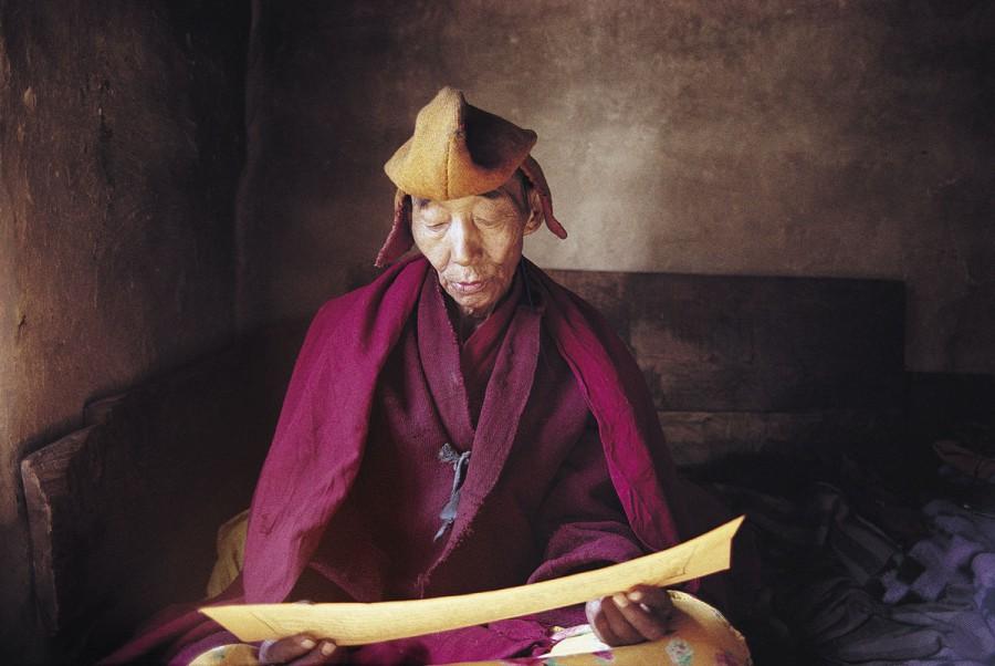 OLD MONK READING ALOUD SUTRAS, PHUKTAL MONASTERY, ZANSKAR, INDIA